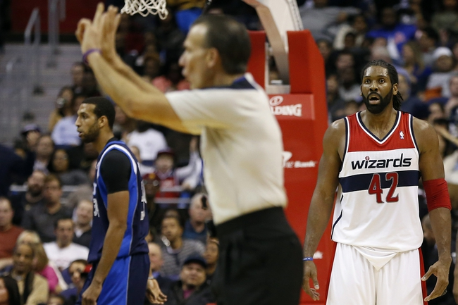 Jan 1, 2014; Washington, DC, USA;  Washington Wizards power forward Nene Hilario (42) reacts after being called for a foul by referee Ken Mauer (41) against the Dallas Mavericks in the fourth quarter at Verizon Center. The Mavericks won 87-78. Mandatory Credit: Geoff Burke-USA TODAY Sports