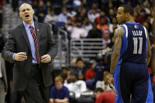 Jan 1, 2014; Washington, DC, USA;  Dallas Mavericks head coach Rick Carlisle (L) argues a call from the court as Mavericks shooting guard Monta Ellis (11) looks on against the Washington Wizards in the second quarter at Verizon Center. The Mavericks won 87-78. Mandatory Credit: Geoff Burke-USA TODAY Sports