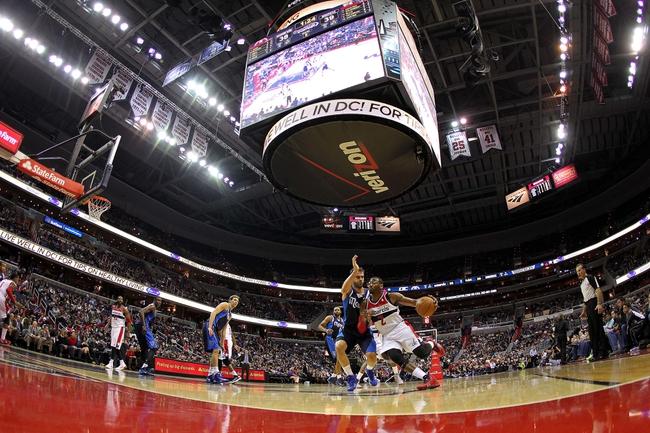 Jan 1, 2014; Washington, DC, USA;  Washington Wizards point guard John Wall (2) dribbles the ball as Dallas Mavericks point guard Jose Calderon (8) defends in the second quarter at Verizon Center. The Mavericks won 87-78. Mandatory Credit: Geoff Burke-USA TODAY Sports