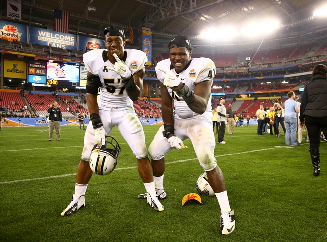 Jan 1, 2014; Glendale, AZ, USA; Central Florida Knights linebacker Troy Gray (left) and linebacker Terrance Plummer celebrate after defeating the Baylor Bears during the Fiesta Bowl at University of Phoenix Stadium. Central Florida defeated Baylor 52-42. Mandatory Credit: Mark J. Rebilas-USA TODAY Sports