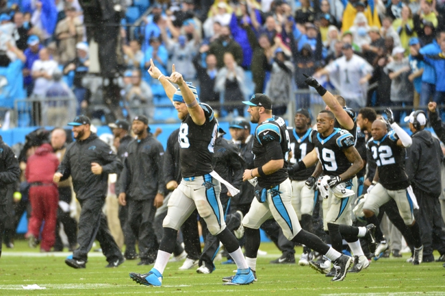 Dec 22, 2013; Charlotte, NC, USA; Carolina Panthers tight end Greg Olsen (88) walks across the field after the game. The Panthers defeated the Saints 17-13 at Bank of America Stadium. Mandatory Credit: Bob Donnan-USA TODAY Sports