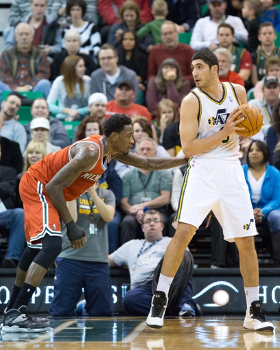 Jan 2, 2014; Salt Lake City, UT, USA; Milwaukee Bucks center Larry Sanders (8) defends against Utah Jazz center Enes Kanter (0) during the first half at EnergySolutions Arena. Mandatory Credit: Russ Isabella-USA TODAY Sports