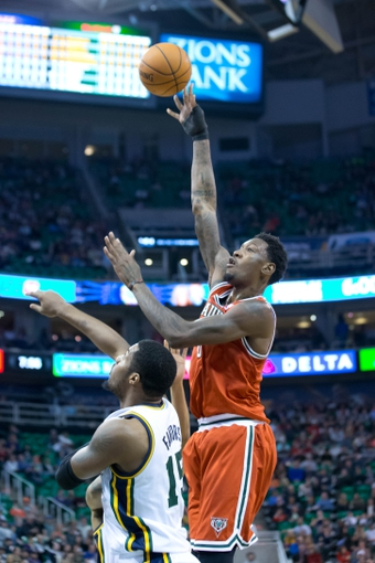 Jan 2, 2014; Salt Lake City, UT, USA; Milwaukee Bucks center Larry Sanders (8) shoots over Utah Jazz power forward Derrick Favors (15) during the first half at EnergySolutions Arena. Mandatory Credit: Russ Isabella-USA TODAY Sports
