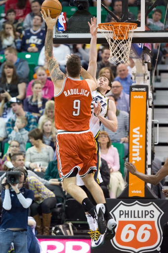 Jan 2, 2014; Salt Lake City, UT, USA; Milwaukee Bucks center Miroslav Raduljica (9) shoots against Utah Jazz shooting guard Gordon Hayward (20) during the second half at EnergySolutions Arena. The Jazz won 96-87. Mandatory Credit: Russ Isabella-USA TODAY Sports