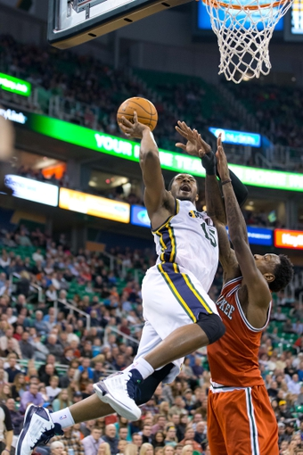 Jan 2, 2014; Salt Lake City, UT, USA; Utah Jazz power forward Derrick Favors (15) shoots against Milwaukee Bucks center Larry Sanders (8) during the second half at EnergySolutions Arena. The Jazz won 96-87. Mandatory Credit: Russ Isabella-USA TODAY Sports