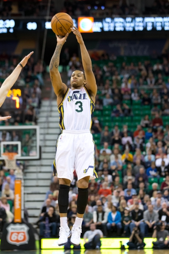Jan 2, 2014; Salt Lake City, UT, USA; Utah Jazz point guard Trey Burke (3) shoots during the second half against the Milwaukee Bucks at EnergySolutions Arena. The Jazz won 96-87. Mandatory Credit: Russ Isabella-USA TODAY Sports