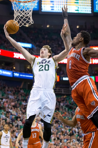 Jan 2, 2014; Salt Lake City, UT, USA; Utah Jazz shooting guard Gordon Hayward (20) shoots against Milwaukee Bucks center Larry Sanders (8) during the second half at EnergySolutions Arena. The Jazz won 96-87. Mandatory Credit: Russ Isabella-USA TODAY Sports
