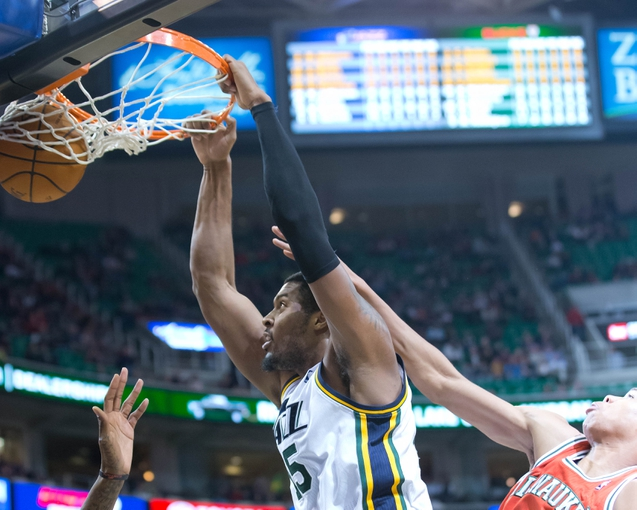 Jan 2, 2014; Salt Lake City, UT, USA; Utah Jazz power forward Derrick Favors (15) dunks during the second half against the Milwaukee Bucks at EnergySolutions Arena. The Jazz won 96-87. Mandatory Credit: Russ Isabella-USA TODAY Sports