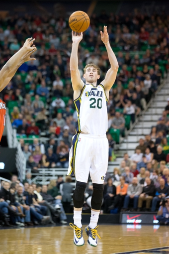 Jan 2, 2014; Salt Lake City, UT, USA; Utah Jazz shooting guard Gordon Hayward (20) shoots during the second half against the Milwaukee Bucks at EnergySolutions Arena. The Jazz won 96-87. Mandatory Credit: Russ Isabella-USA TODAY Sports