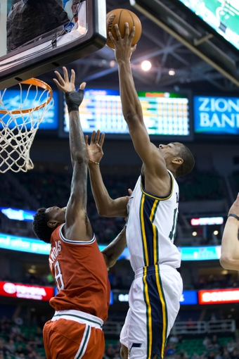 Jan 2, 2014; Salt Lake City, UT, USA; Utah Jazz point guard Alec Burks (10) shoots against Milwaukee Bucks center Larry Sanders (8) during the second half at EnergySolutions Arena. The Jazz won 96-87. Mandatory Credit: Russ Isabella-USA TODAY Sports