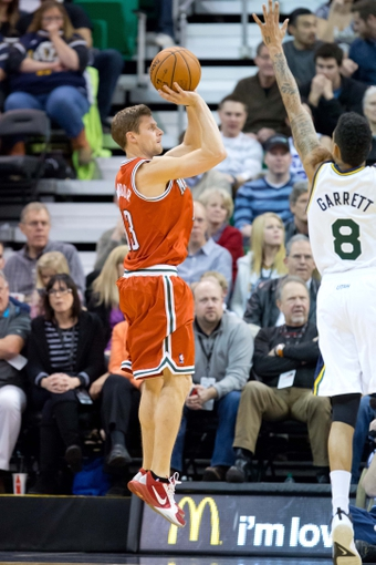 Jan 2, 2014; Salt Lake City, UT, USA; Milwaukee Bucks point guard Luke Ridnour (13) shoots against Utah Jazz point guard Diante Garrett (8) during the second half at EnergySolutions Arena. The Jazz won 96-87. Mandatory Credit: Russ Isabella-USA TODAY Sports