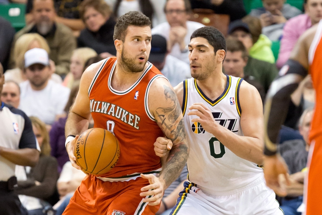 Jan 2, 2014; Salt Lake City, UT, USA; Utah Jazz center Enes Kanter (0) defends against Milwaukee Bucks center Miroslav Raduljica (9) during the second half at EnergySolutions Arena. The Jazz won 96-87. Mandatory Credit: Russ Isabella-USA TODAY Sports