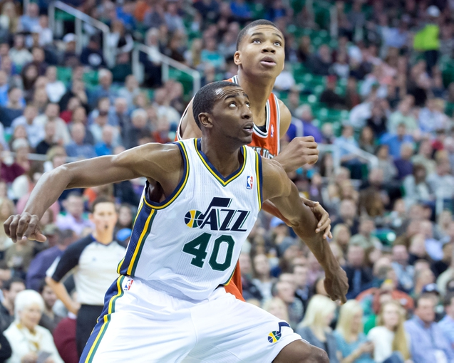 Jan 2, 2014; Salt Lake City, UT, USA; Utah Jazz small forward Jeremy Evans (40) boxes out Milwaukee Bucks shooting guard Giannis Antetokounmpo (34) during the first half at EnergySolutions Arena. The Jazz won 96-87. Mandatory Credit: Russ Isabella-USA TODAY Sports