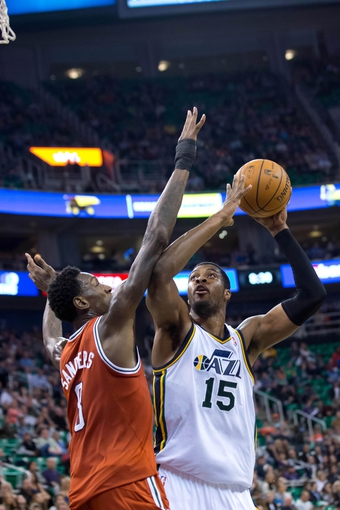 Jan 2, 2014; Salt Lake City, UT, USA; Utah Jazz power forward Derrick Favors (15) looks to shoot against Milwaukee Bucks center Larry Sanders (8) during the second half at EnergySolutions Arena. The Jazz won 96-87. Mandatory Credit: Russ Isabella-USA TODAY Sports