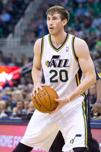 Jan 2, 2014; Salt Lake City, UT, USA; Utah Jazz shooting guard Gordon Hayward (20) controls the ball during the second half against the Milwaukee Bucks at EnergySolutions Arena. The Jazz won 96-87. Mandatory Credit: Russ Isabella-USA TODAY Sports