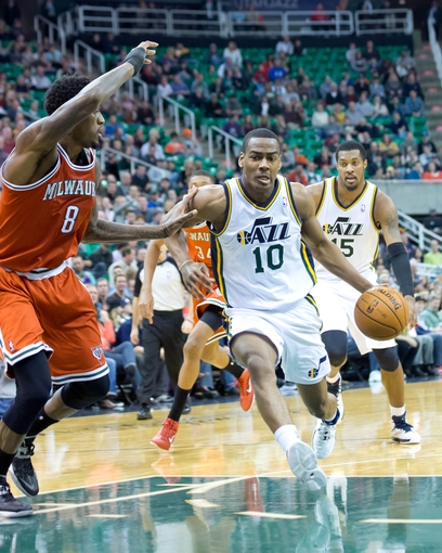 Jan 2, 2014; Salt Lake City, UT, USA; Utah Jazz point guard Alec Burks (10) drives against Milwaukee Bucks center Larry Sanders (8) during the second half at EnergySolutions Arena. The Jazz won 96-87. Mandatory Credit: Russ Isabella-USA TODAY Sports