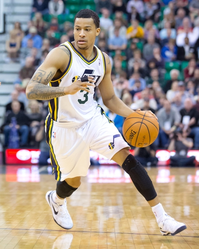 Jan 2, 2014; Salt Lake City, UT, USA; Utah Jazz point guard Trey Burke (3) dribbles during the second half against the Milwaukee Bucks at EnergySolutions Arena. The Jazz won 96-87. Mandatory Credit: Russ Isabella-USA TODAY Sports