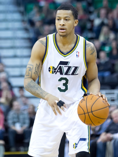 Jan 2, 2014; Salt Lake City, UT, USA; Utah Jazz point guard Trey Burke (3) controls the ball during the second half against the Milwaukee Bucks at EnergySolutions Arena. The Jazz won 96-87. Mandatory Credit: Russ Isabella-USA TODAY Sports