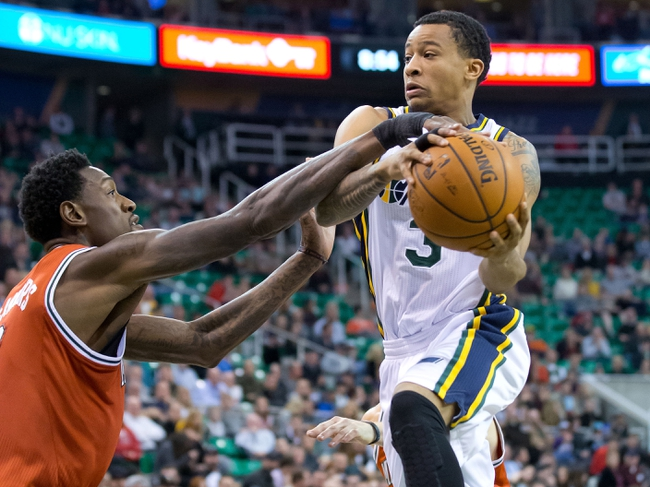 Jan 2, 2014; Salt Lake City, UT, USA; Milwaukee Bucks center Larry Sanders (8) defends against Utah Jazz point guard Trey Burke (3) during the second half at EnergySolutions Arena. The Jazz won 96-87. Mandatory Credit: Russ Isabella-USA TODAY Sports