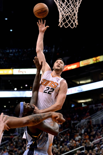 Jan 2, 2014; Phoenix, AZ, USA; Phoenix Suns forward Miles Plumlee (22) lays the ball up over Memphis Grizzlies forward Zach Randolph (50) in the second half at US Airways Center. The Grizzlies won 99-91. Mandatory Credit: Jennifer Stewart-USA TODAY Sports