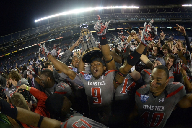 Dec 30, 2013; San Diego, CA, USA; Texas Tech Red Raiders players celebrate with the championship trophy after the 2013 Holiday Bowl against the Arizona State Sun Devils at Qualcomm Stadium. Texas Tech defeated Arizona State 37-23. Mandatory Credit: Kirby Lee-USA TODAY Sports