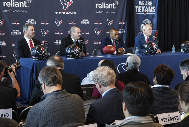 Jan 3, 2014; Houston, TX, USA; Cal McNair (left) and Bill O'Brien (middle left) and Rick Smith (middle right) and Bob McNair (right) hold a press conference to announce Bill O'Brien as the Houston Texans new head coach at Reliant Stadium. Mandatory Credit: Troy Taormina-USA TODAY Sports