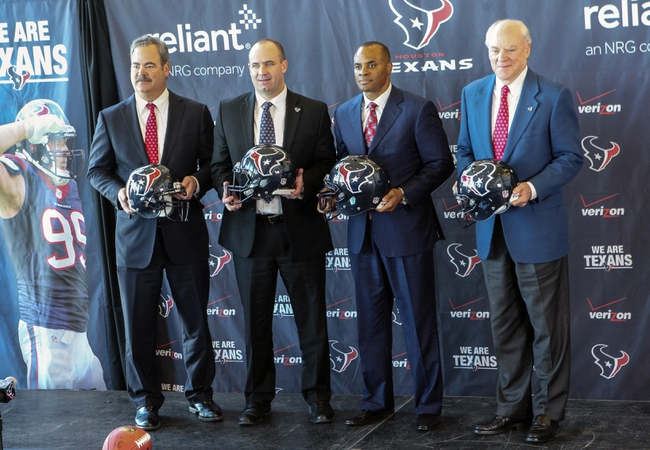 Jan 3, 2014; Houston, TX, USA; Cal McNair (left) and Bill O'Brien (middle left) and Rick Smith (middle right) and Bob McNair (right) pose for a picture as O'Brien is announced as the Houston Texans new head coach during a press conference at Reliant Stadium. Mandatory Credit: Troy Taormina-USA TODAY Sports