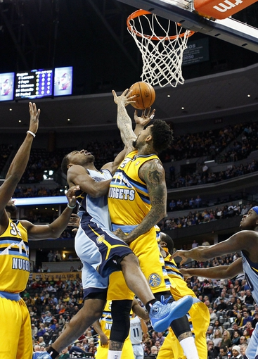 Jan 3, 2014; Denver, CO, USA; Denver Nuggets shooting guard Wilson Chandler (21) fouls Memphis Grizzlies shooting guard Tony Allen (9) in the first quarter at the Pepsi Center. Mandatory Credit: Isaiah J. Downing-USA TODAY Sports