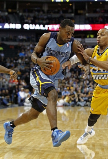 Jan 3, 2014; Denver, CO, USA; Memphis Grizzlies shooting guard Tony Allen (9) drives to the net against Denver Nuggets point guard Randy Foye (4) in the first quarter at the Pepsi Center. Mandatory Credit: Isaiah J. Downing-USA TODAY Sports