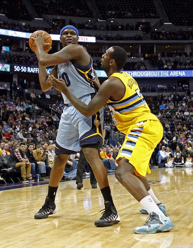 Jan 3, 2014; Denver, CO, USA; Denver Nuggets power forward J.J. Hickson (7) guards Memphis Grizzlies power forward Zach Randolph (50) in the first quarter at the Pepsi Center. Mandatory Credit: Isaiah J. Downing-USA TODAY Sports