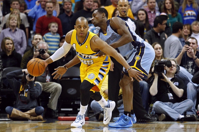 Jan 3, 2014; Denver, CO, USA; Denver Nuggets point guard Randy Foye (4) keeps the ball from Memphis Grizzlies shooting guard Tony Allen (9) in the first quarter at the Pepsi Center. Mandatory Credit: Isaiah J. Downing-USA TODAY Sports
