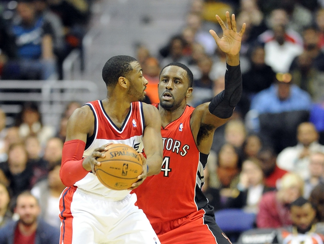 Jan 3, 2014; Washington, DC, USA; Washington Wizards point guard John Wall (2) looks to pass as Toronto Raptors power forward Patrick Patterson (54) defends during the second half at Verizon Center. The Raptors defeated the Wizards 101 - 88. Mandatory Credit: Brad Mills-USA TODAY Sports