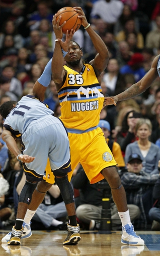 Jan 3, 2014; Denver, CO, USA; Memphis Grizzlies point guard Mike Conley (11) gets caught up with Denver Nuggets small forward Kenneth Faried (35) in the second quarter at the Pepsi Center. Mandatory Credit: Isaiah J. Downing-USA TODAY Sports