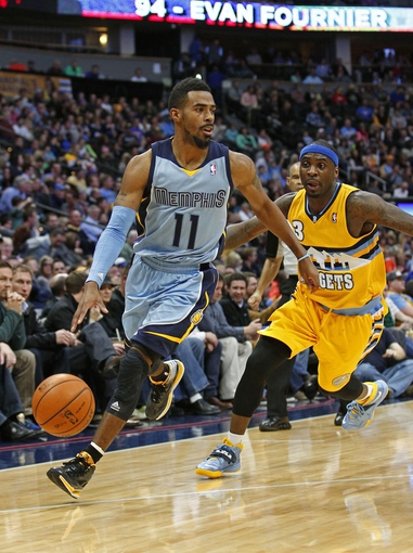 Jan 3, 2014; Denver, CO, USA; Memphis Grizzlies point guard Mike Conley (11) keeps the ball from Denver Nuggets point guard Ty Lawson (3) in the second quarter at the Pepsi Center. Mandatory Credit: Isaiah J. Downing-USA TODAY Sports