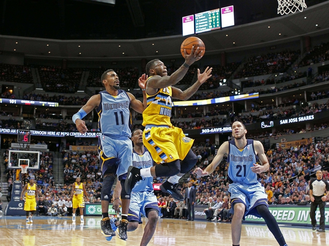 Jan 3, 2014; Denver, CO, USA; Memphis Grizzlies small forward Tayshaun Prince (21) watches as Denver Nuggets point guard Nate Robinson (10) gets past Grizzlies point guard Mike Conley (11) in the fourth quarter at the Pepsi Center. The Nuggets won 111-108. Mandatory Credit: Isaiah J. Downing-USA TODAY Sports