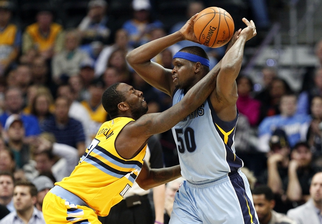 Jan 3, 2014; Denver, CO, USA; Denver Nuggets power forward J.J. Hickson (7) fouls Memphis Grizzlies power forward Zach Randolph (50) in the third quarter at the Pepsi Center. The Nuggets won 111-108. Mandatory Credit: Isaiah J. Downing-USA TODAY Sports