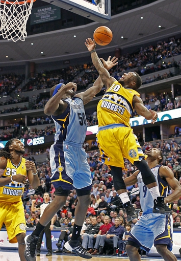 Jan 3, 2014; Denver, CO, USA; Denver Nuggets point guard Nate Robinson (10) and Memphis Grizzlies power forward Zach Randolph (50) battle for a rebound in the fourth quarter at the Pepsi Center. The Nuggets won 111-108. Mandatory Credit: Isaiah J. Downing-USA TODAY Sports