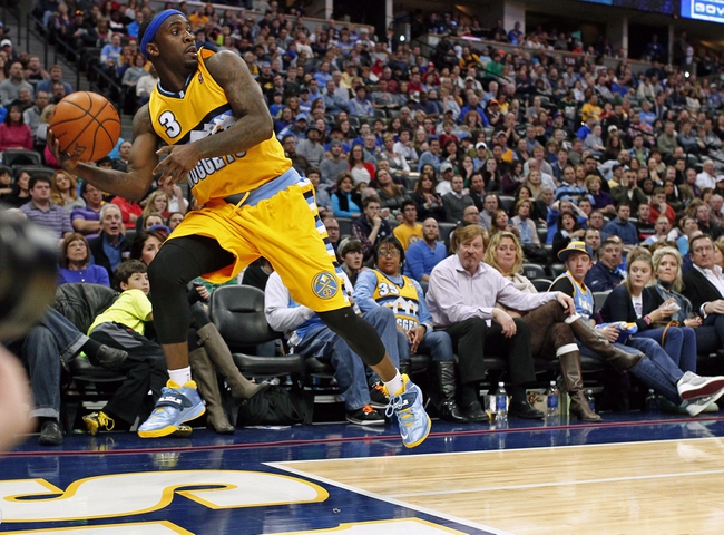 Jan 3, 2014; Denver, CO, USA; Denver Nuggets point guard Ty Lawson (3) keeps the ball in bounds in the fourth quarter against the Memphis Grizzlies at the Pepsi Center. The Nuggets won 111-108. Mandatory Credit: Isaiah J. Downing-USA TODAY Sports