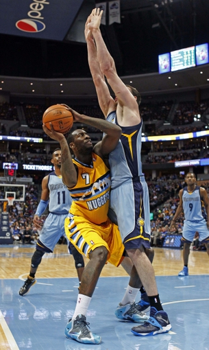 Jan 3, 2014; Denver, CO, USA; Memphis Grizzlies center Kosta Koufos (41) defends against Denver Nuggets power forward J.J. Hickson (7) in the third quarter at the Pepsi Center. The Nuggets won 111-108. Mandatory Credit: Isaiah J. Downing-USA TODAY Sports