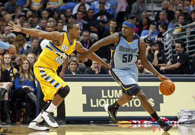 Jan 3, 2014; Denver, CO, USA; Denver Nuggets power forward Darrell Arthur (00) guards Memphis Grizzlies power forward Zach Randolph (50) in the third quarter at the Pepsi Center. The Nuggets won 111-108. Mandatory Credit: Isaiah J. Downing-USA TODAY Sports