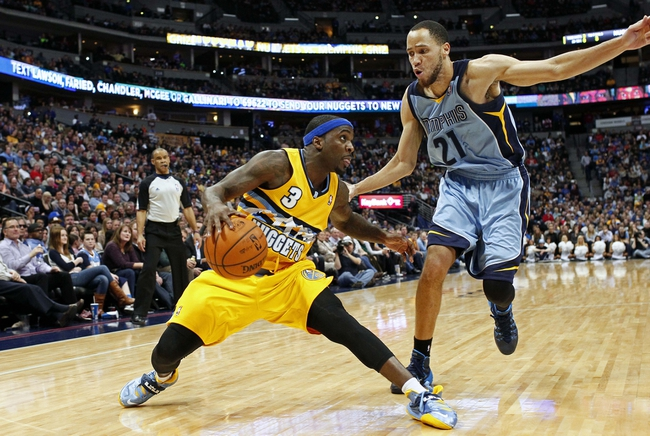 Jan 3, 2014; Denver, CO, USA; Memphis Grizzlies small forward Tayshaun Prince (21) guards Denver Nuggets point guard Ty Lawson (3) in the fourth quarter at the Pepsi Center. The Nuggets won 111-108. Mandatory Credit: Isaiah J. Downing-USA TODAY Sports