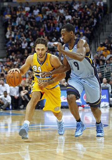 Jan 3, 2014; Denver, CO, USA; Memphis Grizzlies shooting guard Tony Allen (9) guards Denver Nuggets shooting guard Evan Fournier (94) in the third quarter at the Pepsi Center. The Nuggets won 111-108. Mandatory Credit: Isaiah J. Downing-USA TODAY Sports