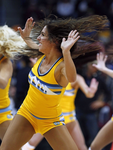 Jan 3, 2014; Denver, CO, USA; A Denver Nuggets dancer performs in the fourth quarter against the Memphis Grizzlies at the Pepsi Center. The Nuggets won 111-108. Mandatory Credit: Isaiah J. Downing-USA TODAY Sports