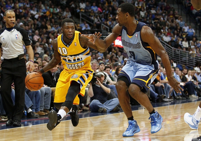Jan 3, 2014; Denver, CO, USA; Memphis Grizzlies shooting guard Tony Allen (9) guards Denver Nuggets point guard Nate Robinson (10) in the fourth quarter at the Pepsi Center. The Nuggets won 111-108. Mandatory Credit: Isaiah J. Downing-USA TODAY Sports