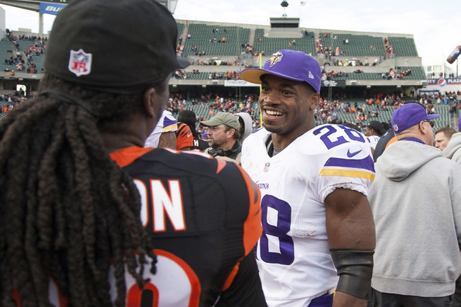 Dec 22, 2013; Cincinnati, OH, USA; Minnesota Vikings running back Adrian Peterson (28) talks with a Cincinnati Bengals player on the field post game at Paul Brown Stadium. Cincinnati Bengals beat the Minnesota Vikings by the score of 42-14. Mandatory Credit: Trevor Ruszkowksi-USA TODAY Sports