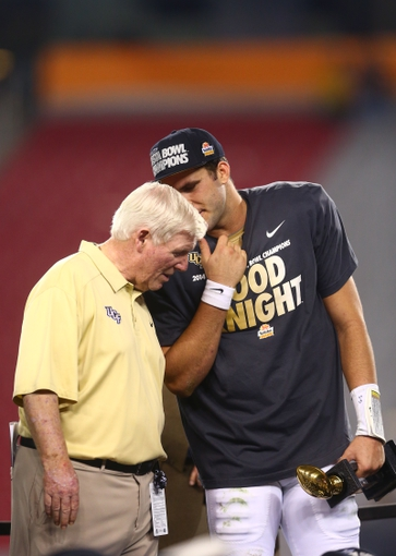 Jan 1, 2014; Glendale, AZ, USA; Central Florida Knights head coach George O'Leary (left) talks with quarterback Blake Bortles as they celebrate after defeating the Baylor Bears during the Fiesta Bowl at University of Phoenix Stadium. Central Florida defeated Baylor 52-42. Mandatory Credit: Mark J. Rebilas-USA TODAY Sports