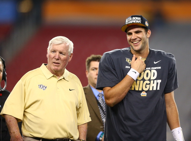 Jan 1, 2014; Glendale, AZ, USA; Central Florida Knights head coach George O'Leary (left) and quarterback Blake Bortles celebrate after defeating the Baylor Bears during the Fiesta Bowl at University of Phoenix Stadium. Central Florida defeated Baylor 52-42. Mandatory Credit: Mark J. Rebilas-USA TODAY Sports