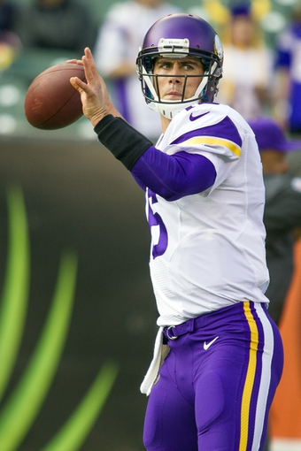 Dec 22, 2013; Cincinnati, OH, USA;  Minnesota Vikings quarterback Matt Cassel (16) warms up passing before the game against the Cincinnati Bengals at Paul Brown Stadium. Cincinnati Bengals beat the Minnesota Vikings by the score of 42-14. Mandatory Credit: Trevor Ruszkowksi-USA TODAY Sports