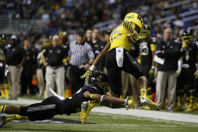 Jan 4, 2014; San Antonio, TX, USA; West wide receiver Frank Iheanacho (15) is tackled by East defensive back Erick Smith (22) during U.S. Army All-American Bowl high school football game at the Alamodome. Mandatory Credit: Soobum Im-USA TODAY Sports