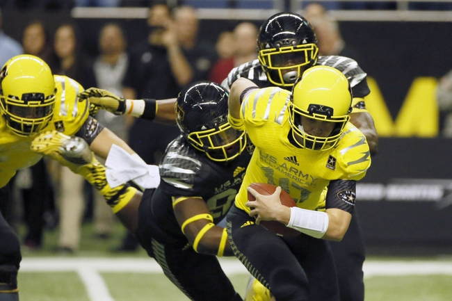 Jan 4, 2014; San Antonio, TX, USA; West quarterback Kyle Allen (10) tries to escape from pressure during U.S. Army All-American Bowl high school football game at the Alamodome. Mandatory Credit: Soobum Im-USA TODAY Sports